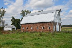 Brick barn with metal roof stands empty Stock Images