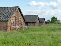 Brick barracks in the meadow in the former concentration camp. Auschwitz, Birkenau Royalty Free Stock Image