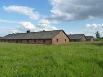 Brick barracks in the meadow in the former concentration camp. Auschwitz, Birkenau Royalty Free Stock Photography