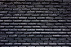 Brick wall pattern. Brick in black colour work wall pattern, craftmanship in construction building, selective focus Royalty Free Stock Photos
