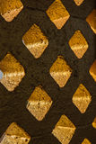 Brick block gold and light through hole Royalty Free Stock Photography