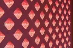 Brick block pink and light through hole Royalty Free Stock Image