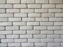 Brick block wall background in living room at home, white wall in house , restaurant or cafe, white big brick block wall wallpaper. In cafe on horizontal side Royalty Free Stock Images