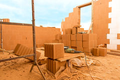 Brick by Brick,  build a house on your own. Building a home. Power tools on the dusty construction site. House under construction Royalty Free Stock Photo