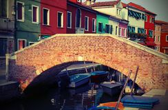 Brick bridge over the navigable channel island of Burano with vi. Brick bridge over the navigable channel island of Burano in northern Italy near Venice with Stock Images