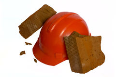 Brick is broken about a helmet. The brick is broken about a helmet on a white background isolated Royalty Free Stock Photos