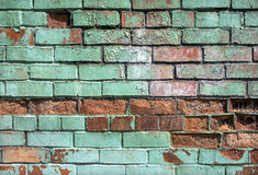 Brick broken in an old wall background Stock Image