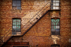Brick building. Side of a building in a warehouse district stock photo