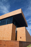 Brick Building. A modern brick building with a blue sky Royalty Free Stock Images