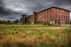 Brick Building Abandoned. A brick building sits in a field abadoned Royalty Free Stock Photos