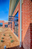 Brick building architecture with suncreen shades Stock Photo