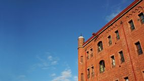 Brick building and clear sky. Brick building and blue sky royalty free stock image