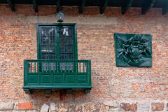 Brick Building with Green Window Royalty Free Stock Photography