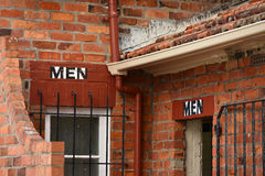 Brick building with men toilets Stock Photo
