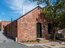 Brick building. With the nice blue sky in the background Stock Images