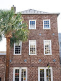 Brick Building by Palm Tree with Open Sign Royalty Free Stock Images