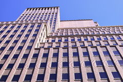 Brick building. Perspective shot of tall brick building stock photography