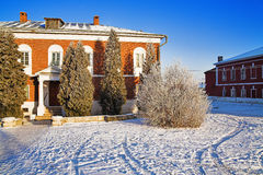 Brick building and tree in winter Royalty Free Stock Photo