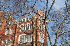 Brick building in London on a winter day. Typical red brick building on a winter sunny day in London, United Kingdom royalty free stock photo