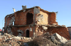 Brick building under demolition stock photography
