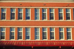 Old school architecture brick and windows facade Royalty Free Stock Image