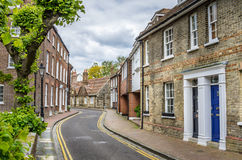 Brick Buildings along a Narrow Street in England Stock Photography