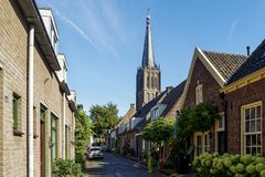 Brick buildings near the tower of the Carillon St. Martin's Church in Doesburg, The Netherlands