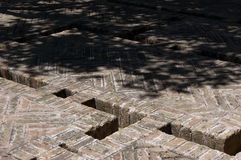 Brick-built ground with system of water mains. Royalty Free Stock Photos
