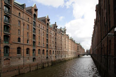 Brick-built Speicherstadt. The Speicherstadt, an ancient brick-built warehouse complex, is the historical center of the port of Hamburg, Germany. Still today the Royalty Free Stock Images