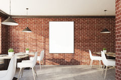Brick cafe interior with a vertical poster Stock Photo