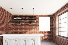 Brick cafe interior with a white stand. Brick wall cafe with a white bar stand, a row of stools, a vertical poster hanging near a wooden shelf and three ceiling Stock Photo