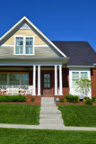 Brick Cape Cod House. Green and Yellow Brick cape cod dream house royalty free stock photography