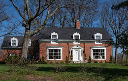 Brick Cape Cod House with Inset Dormers Royalty Free Stock Image