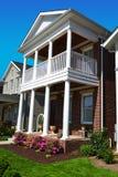 Brick Cape Cod Style Home with Porch. Brick cape cod style home with large front porch on both levels Stock Image