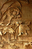 Brick carvings of lotus flowers. On the wall Stock Photos