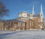 Brick Cathedral in Quebec in winter. Brick Cathedral in Saint-Félicien Quebec in winter Royalty Free Stock Image