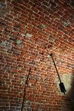 Brick ceiling. With a wrecked lamp stock photo