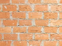 Brick and cement wall in horizontal direction. Clay and cement brick wall in horizontal direction, close-up Stock Images