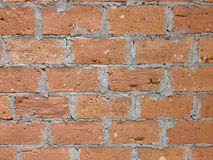 Brick and cement wall in horizontal direction. Clay and cement brick wall in horizontal direction, close-up Royalty Free Stock Images