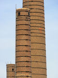 Brick chimney. In a factory Royalty Free Stock Photography