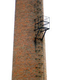 Brick chimney. With steel ladder and chair royalty free stock photos
