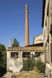 Brick chimney of an abandoned factory royalty free stock photography