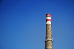 The brick chimney against the blue sky Royalty Free Stock Photos