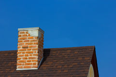 The brick chimney in bright sunlight Royalty Free Stock Photo
