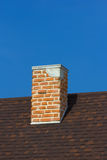 The brick chimney in bright sunlight Royalty Free Stock Photos