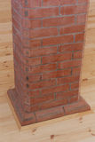 Brick chimney going straight up through the floor Royalty Free Stock Images