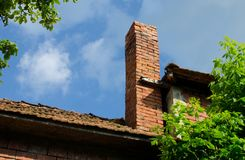 Brick chimney. On house in country side Stock Image