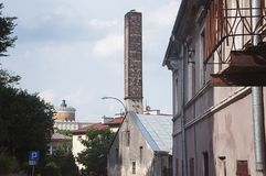 Brick chimney in industrial area of the city. Royalty Free Stock Photo