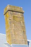 Brick chimney on roof blue sky copy space Stock Photography