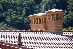 Brick chimneys. Two brick chimneys on a italian house Royalty Free Stock Photography